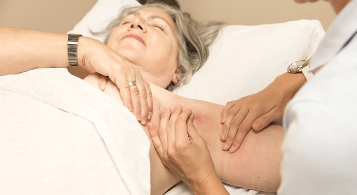 mature woman getting lymphphedema therapy.