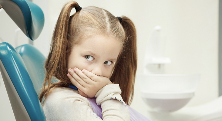girl sitting in dentist chair