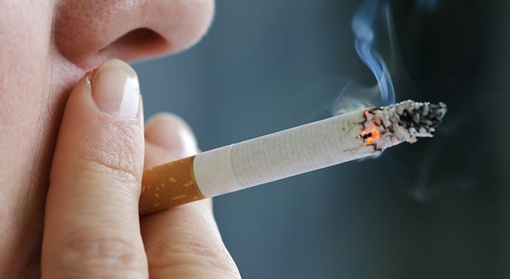 close up of a woman smoking