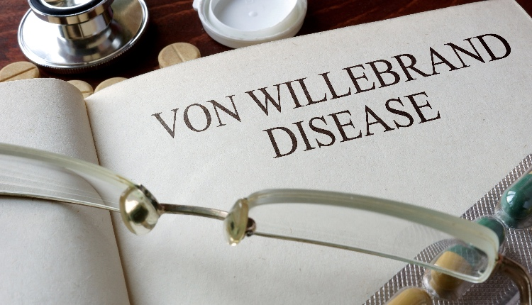 Book with diagnosis Von Willebrand disease and pills.
