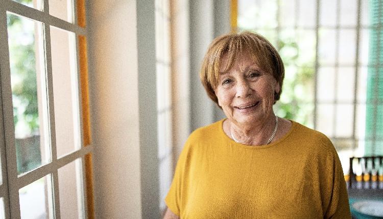 Portrait of smiling senior woman near window