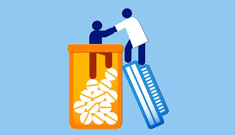 person being helped from a pill bottle by a healthcare provider - addiction treatment concept