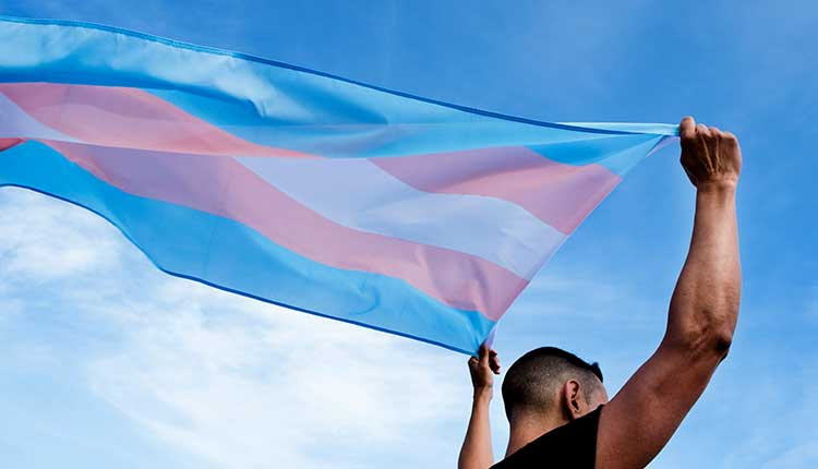 young person with a transgender pride flag
