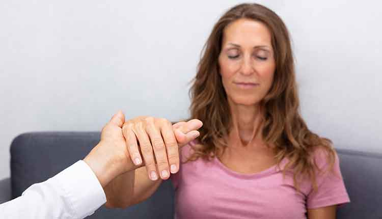 Hypnotherapist Holding Woman Hand During Hypnotherapy