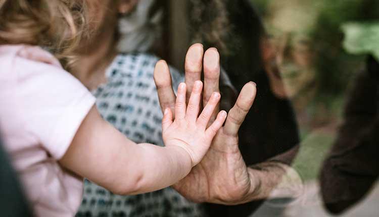 Little Girl Visits Grandparents Through Window -