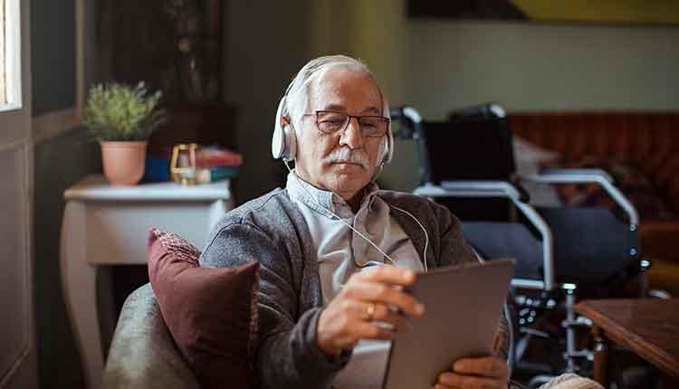 Senior Man using a Tablet at Home