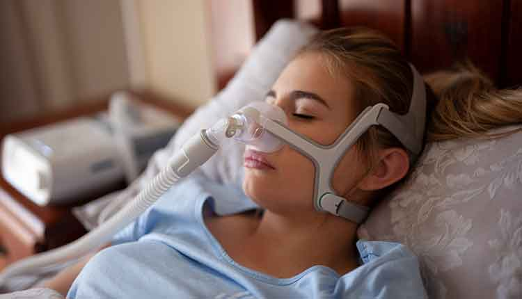 woman with cpap machine on