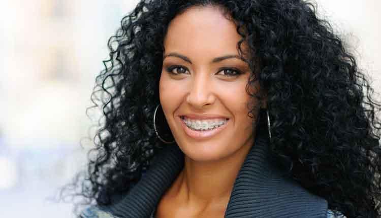 Happy black girl with braces