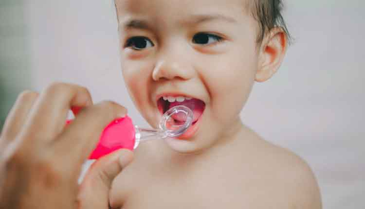 girl during checking tooth and by dental mirror tools toy